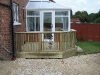Deck to form correct height outside conservatory