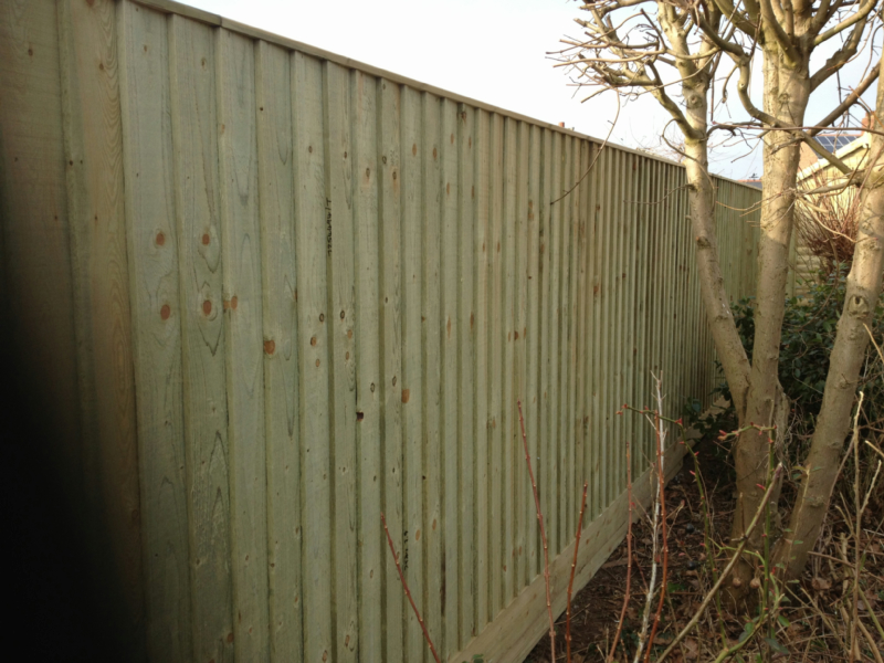 Solid 6ft tanalised feather edge fencing with gravel board and cap, 4